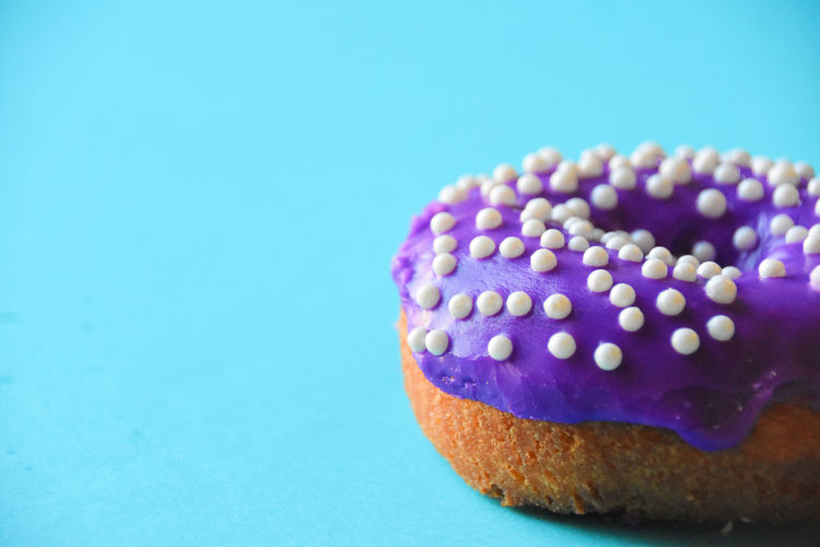 colorful doughnuts and colorful backrounds Blue Close-up Cupcake Day Doughnuts Food Food And Drink Freshness Indoors  Indulgence No People Polka Dot Purple Ready-to-eat Sweet Sweet Food Temptation Vibrant Vibrant Color