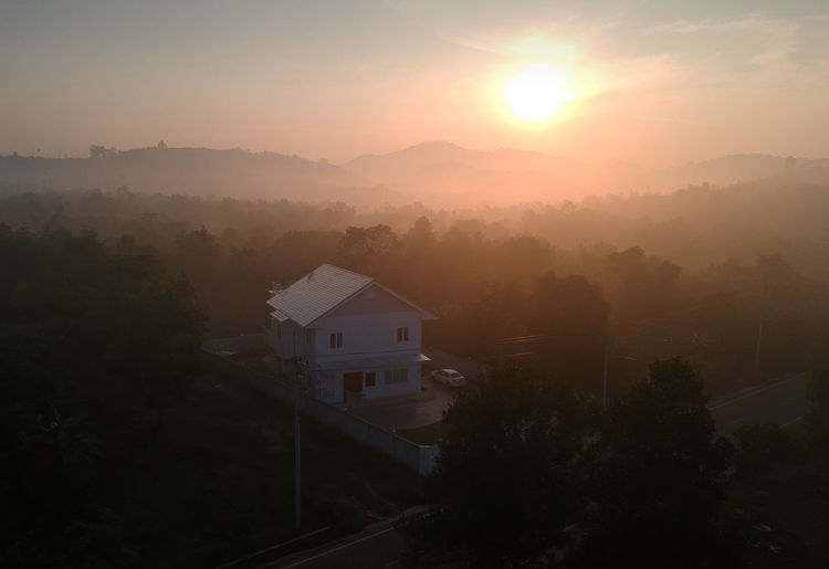 My house at sunrise with foggy background Morning Nature Architecture Beauty In Nature Building Building Exterior Built Structure Fog Heat - Temperature House Mountain Nature No People Outdoors Plant Residential District Scenics - Nature Sky Sun Sunlight Sunrise Sunset Tranquil Scene Tree Wide Angle
