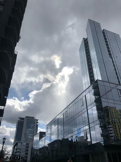 Whispers shared amongst the clouds Low Angle View Architecture Sky Cloud - Sky Building Exterior Built Structure Skyscraper Visual Creativity
