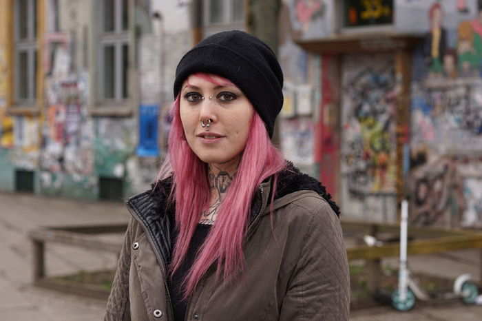 Alternative Authentic Casual Clothing Emo Girl Graffiti Inked Lifestyles Looking At Camera Person Pierced Piercing Pink Hair Portrait Punk Real People Street Tattoo Tattooed Urban Woman Young Adult Young Women Youth