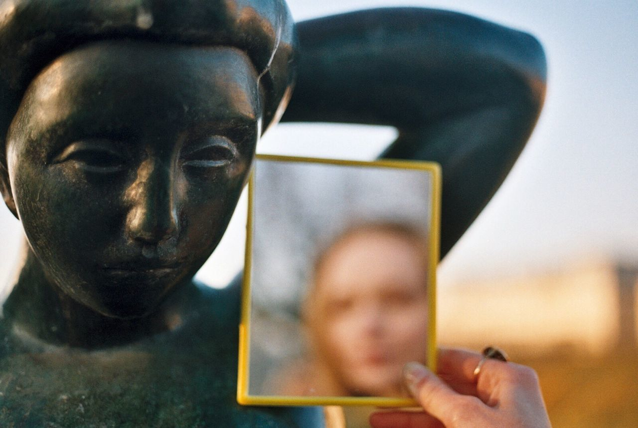 human representation, statue, focus on foreground, close-up, holding