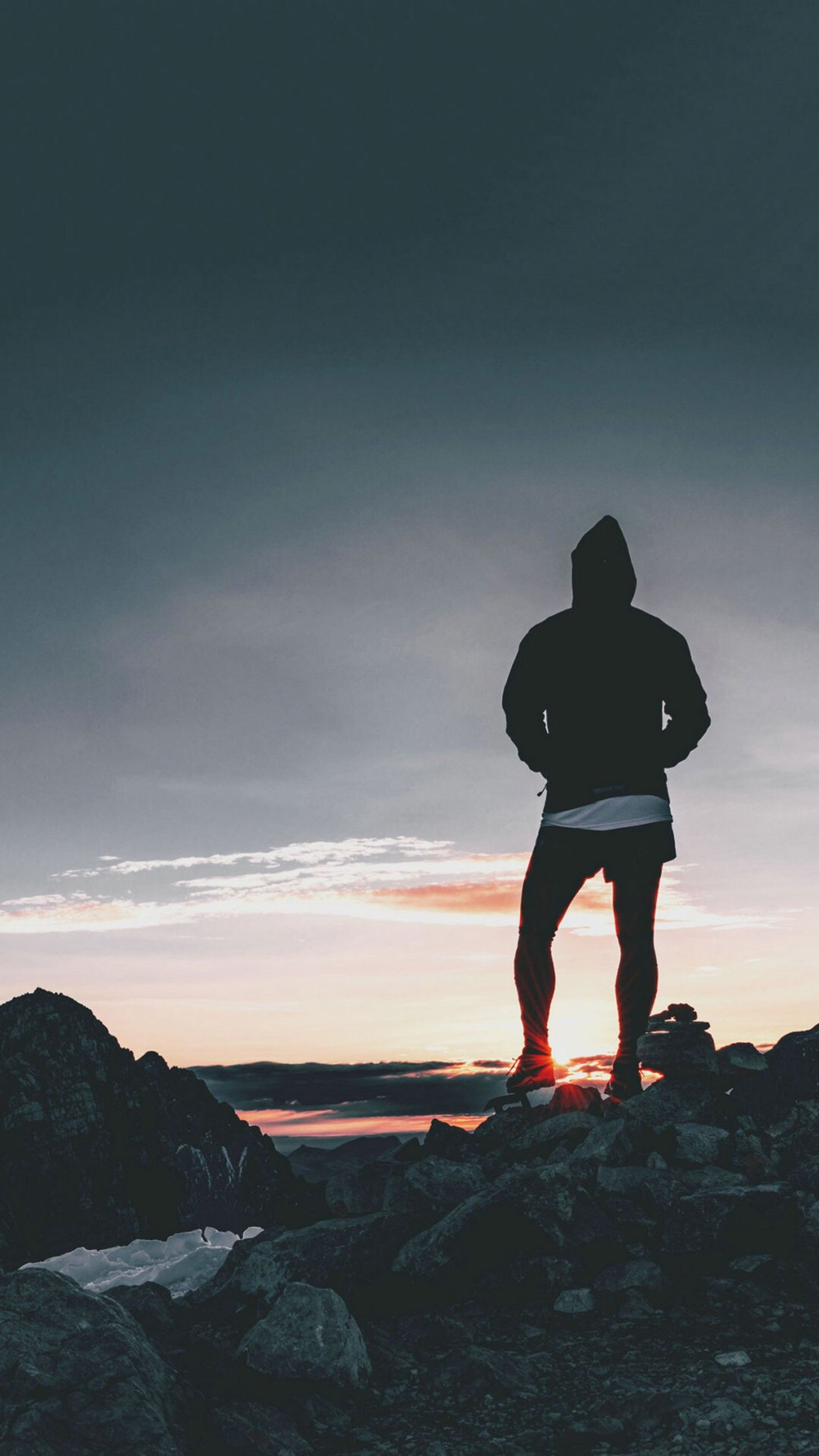full length, lifestyles, leisure activity, standing, silhouette, sky, men, rear view, sunset, rock - object, tranquil scene, person, tranquility, scenics, nature, beauty in nature, landscape, casual clothing
