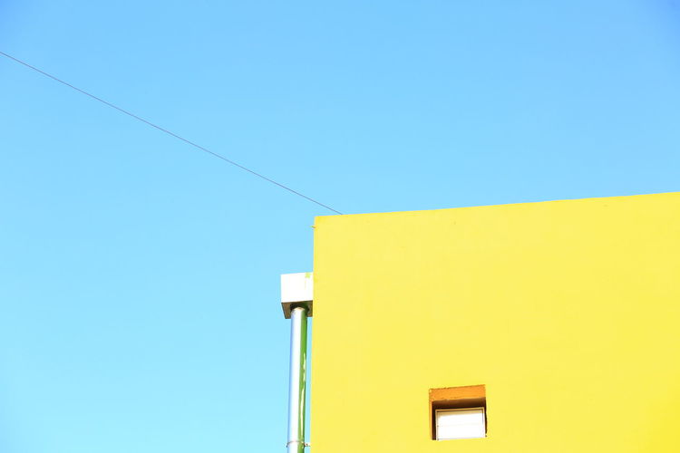 City EyeEmNewHere Minimalist Architecture Architectural Column Architecture Blue Building Building Exterior Built Structure Cable Colorful Copy Space Electricity  Minimalism Multi Colored Nature No People Outdoors Pastel Simplicity Sky Still Life Technology Wall - Building Feature Yellow Visual Creativity