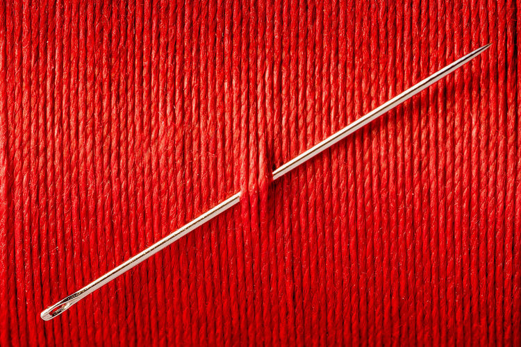 Sewing Backgrounds Close-up Full Frame Indoors  Metal Needle No People Pattern Red Red Background Sew Silver Colored Single Object Still Life Textile Textured  Thread Thread Spool Vibrant Color