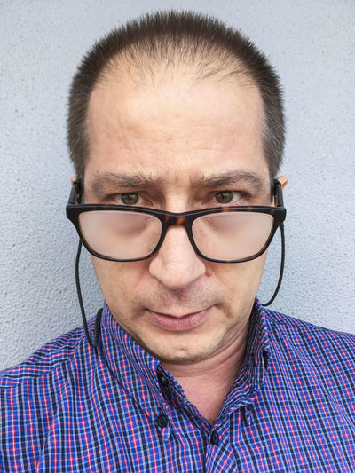 Man against a wall, wearing fogged up prescription glasses. Adult Balding Balding Man Close-up Day Eyeglasses  Fogged Up Fogged Up Glasses Headshot Men One Person People Portrait Prescription Glasses Real People Young Adult