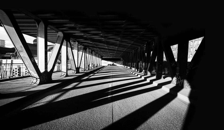 Oberhafenbrücke, Hamburg Hamburg Oberhafenbrücke Architectural Column Architecture Bridge - Man Made Structure Built Structure Contrast Covered Bridge Day In A Row Indoors  No People Shadow Sunlight The Way Forward Transportation Underneath