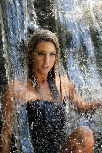 Portrait of woman enjoying waterfall