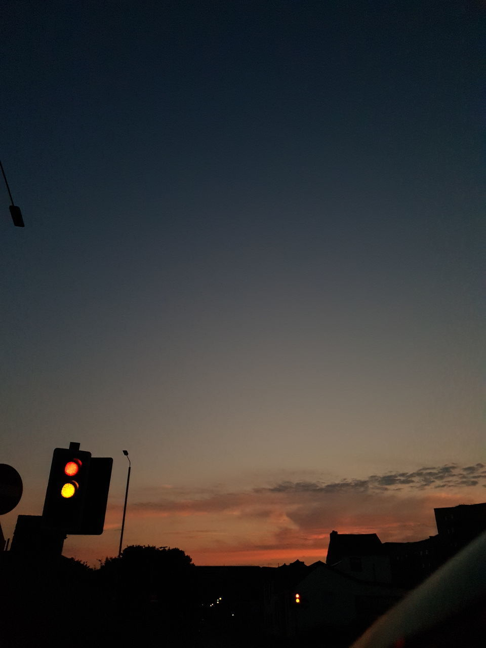 SILHOUETTE OF TRAFFIC AT SUNSET