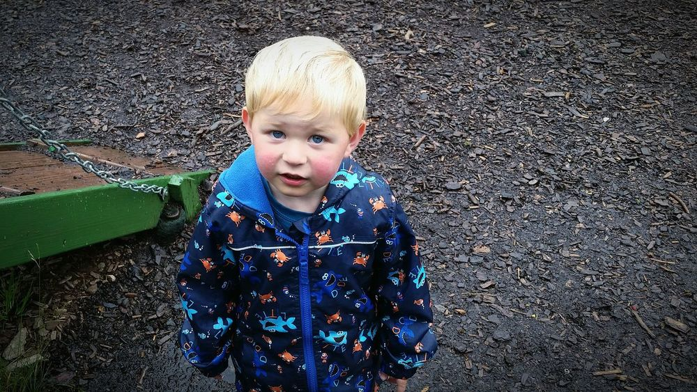 Boy Looking Up Child Blonde Park Blue Eyes Rainy Day Son Horizontal One Boy Only Leisure Activity Fun Exploring Colour Image Rain Jacket Pattern Children Only Childhood Caucasian Memories Outdoors Outside Day Weather