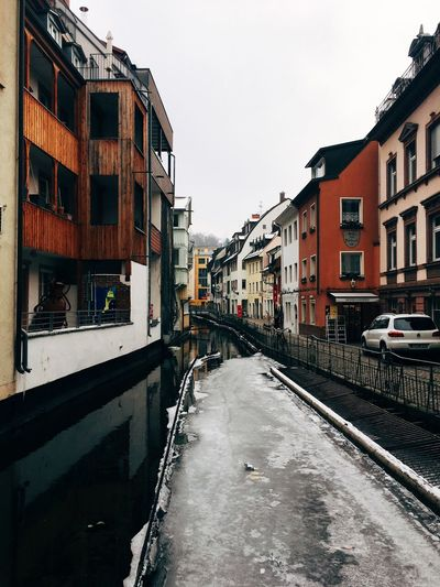 Canal Architecture Building Exterior Built Structure Canal City Cityscape Cold Weather Day Floating On Water Freiburg Houses Ice Natural Disaster No People Outdoors River Sky Water Waterfront Waterway