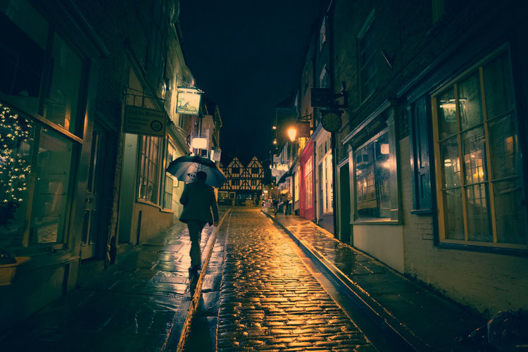 Cobblestone Streets Lincoln Lincolnshire Raining Alley Architecture Built Structure City City Life Cobblestone Direction Illuminated Neon Night Nightlife One Person Sidewalk Steephill Street The Way Forward Umbrella