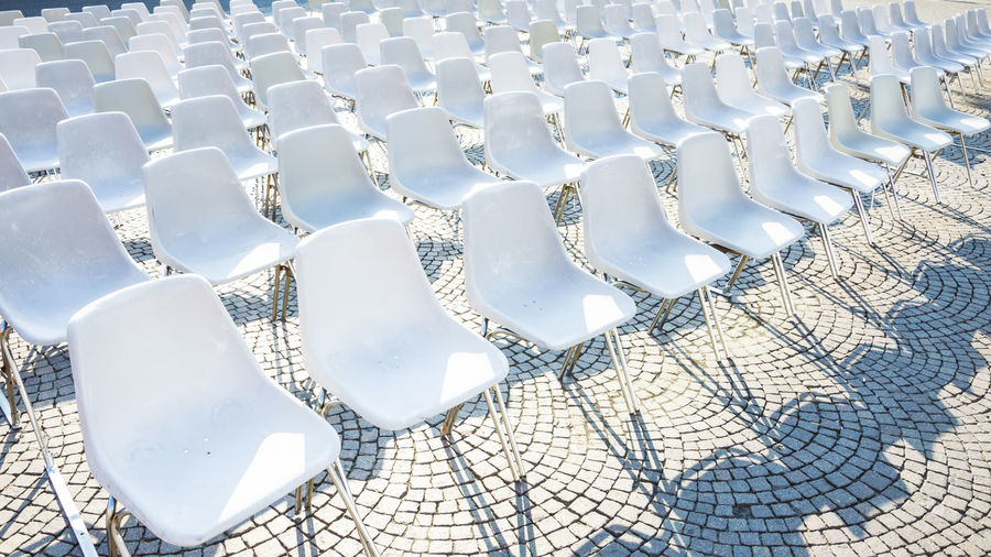 Full frame shot of empty chairs arranged outdoors