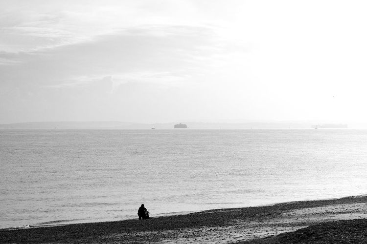 Inspecting The Beach Beach Beauty In Nature Blackandwhite Horizon Horizon Over Water Looking At View One Person Outdoors Real People Sea Sky Tranquility Water