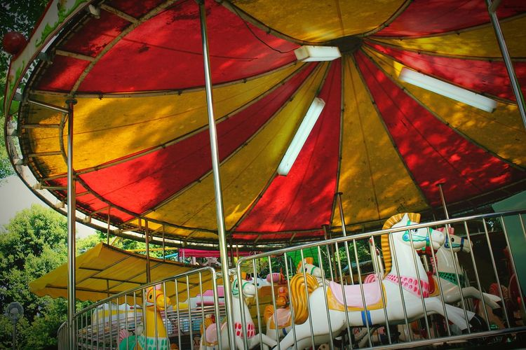 Low Angle View Of Horses At Carousel