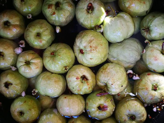 Full frame shot of guavas in water