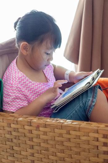 Girl sitting on book