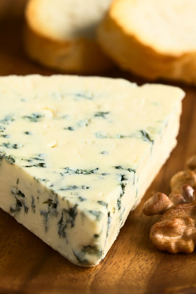 Blue cheese with walnut and bread slices on wooden plate, photographed with natural light (Selective Focus, Focus one third into the cheese) Blue Cheese Breakfast Nuts Smelly Snack Textured  Blue Mold Blue Mold Cheese Cheese Close-up Dairy Dairy Product Delicacy Flavor Food Food And Drink French French Food Gourmet Ingredient Nut Piece Snack Vertical Walnut