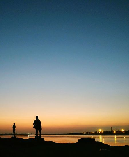 Done That. Silhouette Sunset Sea Reflection Dusk Night Sky People Horizon Over Water Two People Vacations Paint The Town Yellow EyeEm Selects The Week On EyeEm EyeEmNewHere Smartphonephotograhy Minimalism Tranquility