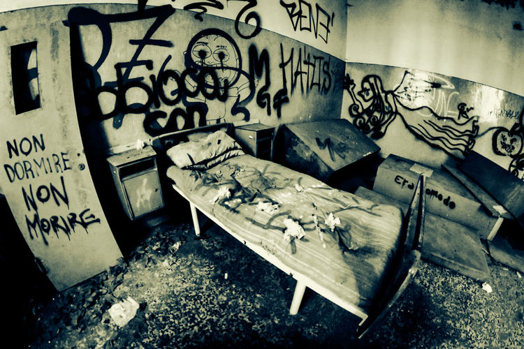 Mental Hospital  Graffiti Abandoned No People Indoors  Architecture Text Damaged Day Communication High Angle View Messy Old Western Script Destruction Obsolete Dirt Built Structure Decline Ruined
