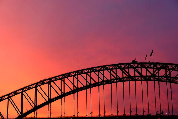 Silhouette Sydney Harbor Bridge Against Sky During Sunset
