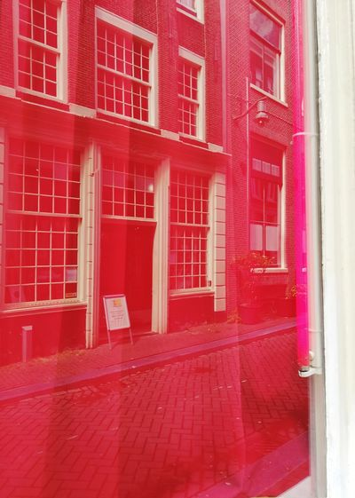 Red light district window with closed red curtains Red Curtain Style Urban District Closed Rest Light Enjoying Life Streetphotography Shop Window Landmark Travel Destinations Cultural Reflection Romantic Mustvisit Visiting Walking Around Sexygirl Famous Street Traditional Red Architecture Built Structure Building Exterior Entrance