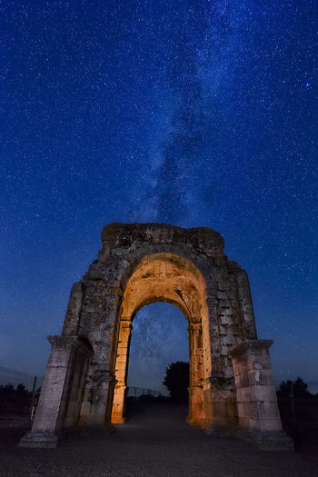 Low angle view of old ruin against sky at night