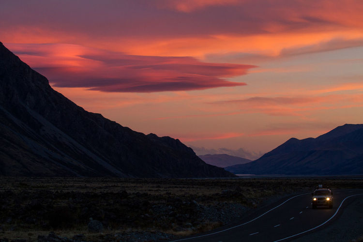 A brilliant sunset while stopping by Mt Cook National Park on a road trip in New Zealand. 4x4 Beauty In Nature Cloud - Sky Drive Mountain Mt Cook Nature Road Trip Sunset