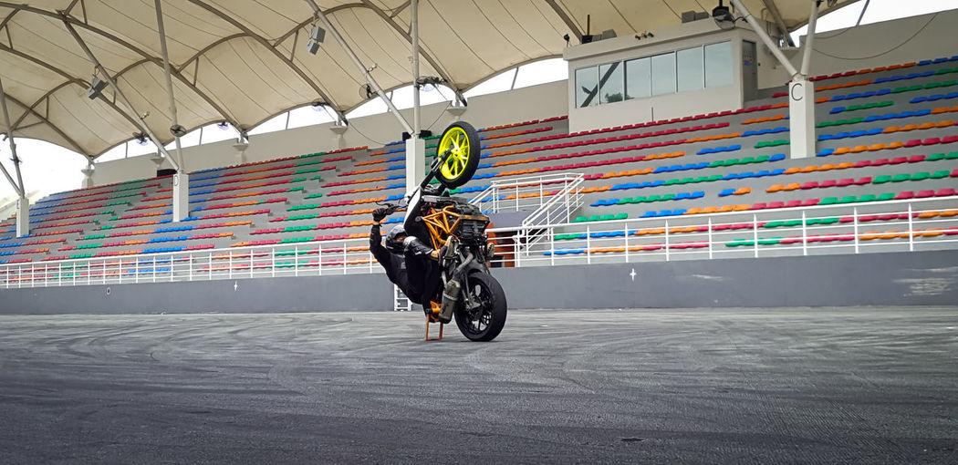 Wheelie Bar KTMRacing Stunt Biking Bike Live Show Stunt Performer Ktm Duke 390 Stunt Show Stunt Rider Livestuntshow Liveshow Stuntlegendsarena Stuntperformer Malaysia Movieanimationparkstudio Wheelie Wheeliebar Headwear Full Length Multi Colored Innovation