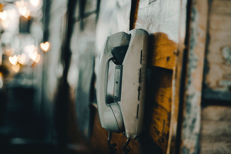 Metal No People Focus On Foreground Close-up Indoors  Wood - Material Old Technology Wall - Building Feature Telephone Hanging Selective Focus Weathered Lighting Equipment Abandoned Illuminated Electricity  Day Electric Lamp