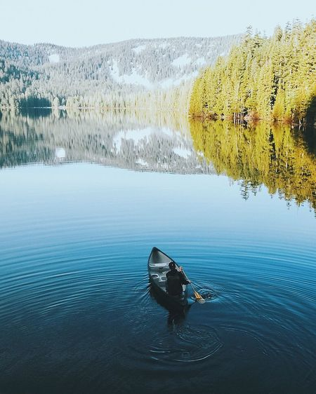 High angle view of man rowing boat at lake