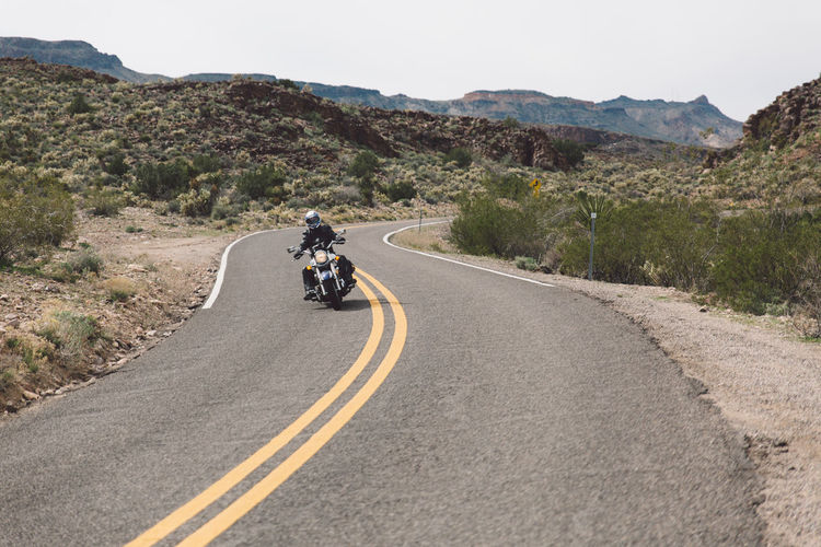 Arid Climate Arizona Clear Sky Day Landscape Men Motorcycle Mountain Mountain Range Mountain Road Nature One Person Outdoors Real People Road Road Roadtrip Route 66 Route66 Sky The Way Forward Tourist Attraction  Tourist Destination Transportation Winding Road Done That.