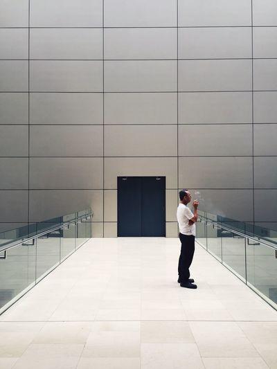Full length of people walking on tiled floor