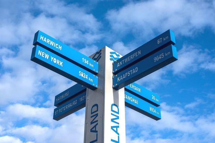 EyeEm Selects Travel Distance Direction Guidance Cloud - Sky Text Communication Arrow Symbol Road Sign Sky Blue Bluesky World Traveltheworld Nikon Nikond750 Nikonphotography Skyscape Hoekvanholland Netherlands