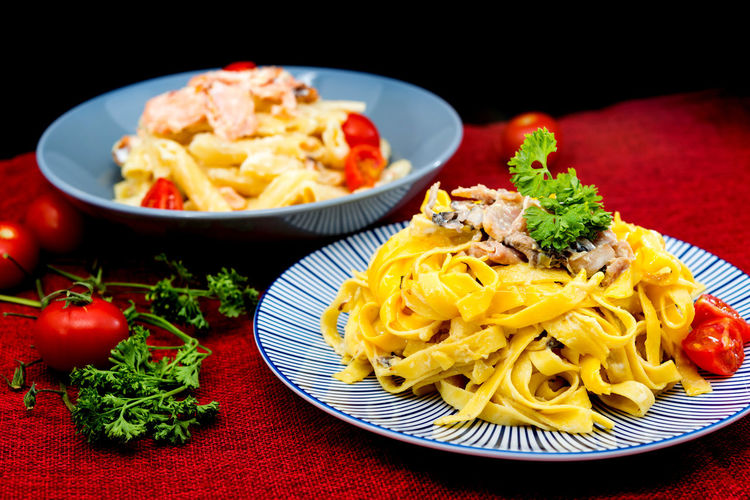 Close-up of pasta on table against black background