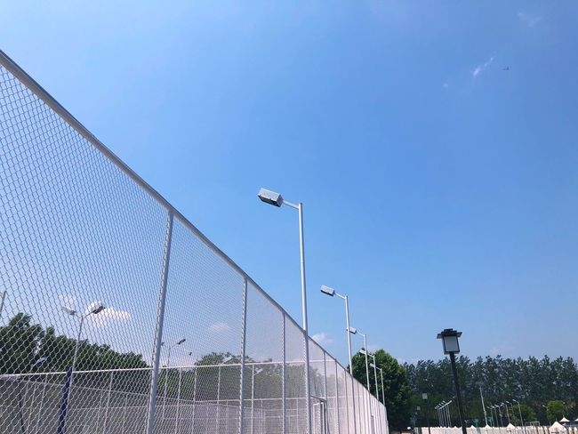 Sky Plant Nature Blue Day Fence Lighting Equipment Boundary Clear Sky No People Architecture