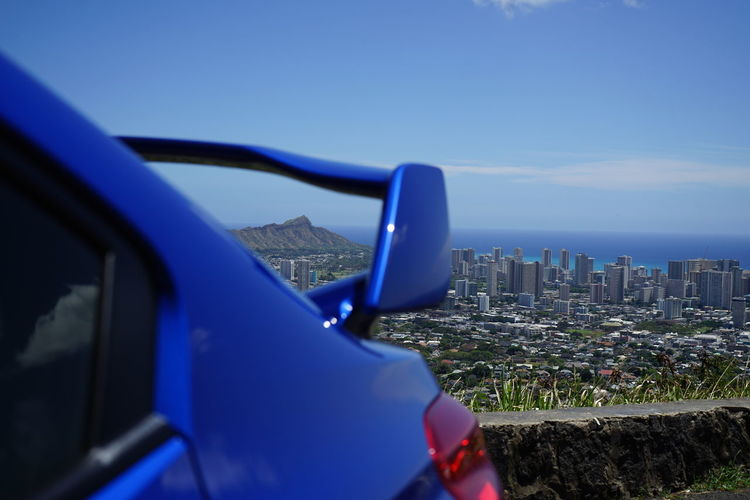 Blue Cityscape City Skyscraper No People Sky Outdoors Architecture Urban Skyline Modern Building Exterior Day Nature Honolulu, Hawaii Oahu / Hawaii Horizon Over Water Landscape Point Of View Grass Downtown District City Tree Sea Beach Water