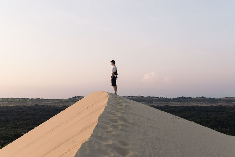 Adventure Beauty In Nature Desert Mui Ne Nature One Person Outdoors People Real People Sand Sand Dune Sky Sunset Travel Travel Destinations Travel Photography Vietnam Live For The Story The Great Outdoors - 2017 EyeEm Awards Done That.
