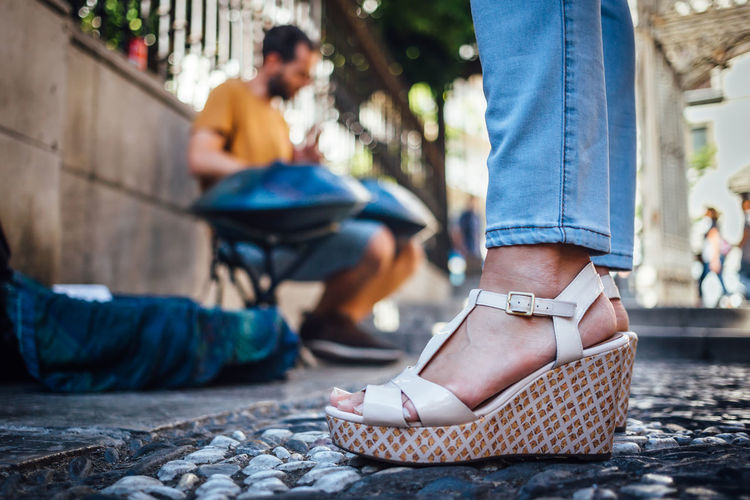 City City Life Cobblestone Foot Footwear Granada Jeans Low Section Person Selective Focus Shoes Sitting SPAIN Street Streetart Woman