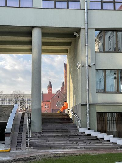 Bridge amidst buildings in city against sky