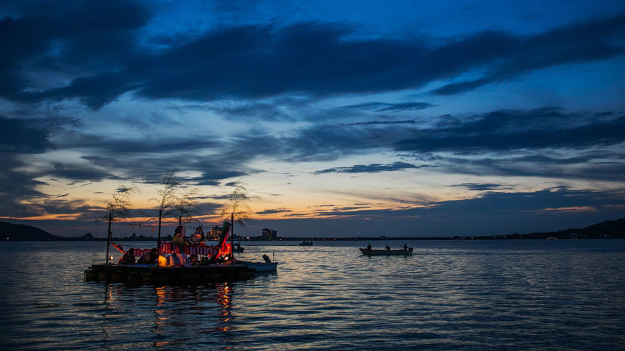 Nautical Vessel Transportation Sky Cloud - Sky Water Mode Of Transportation Sea Sunset Beauty In Nature Scenics - Nature Nature Waterfront Sailing Travel Outdoors Tranquil Scene Tranquility Group Of People Idyllic Sailboat Fishing Boat