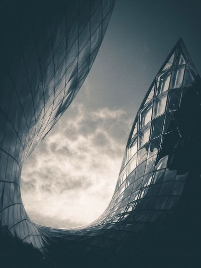 Light   Low Angle View Architecture Built Structure Building Exterior Sky Glass - Material Modern Office Building Cloud Outdoors Tall Cloud - Sky Day Tall - High Geometric Shape Cloudscape Office Block Building Story No People Dramatic Sky Emporia Reflection Clouds And Sky Clouds Moody