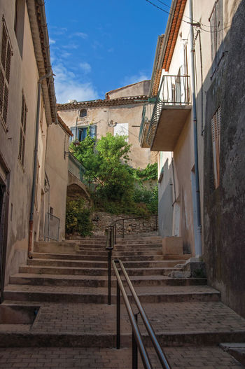 Low angle view of steps amidst buildings in town
