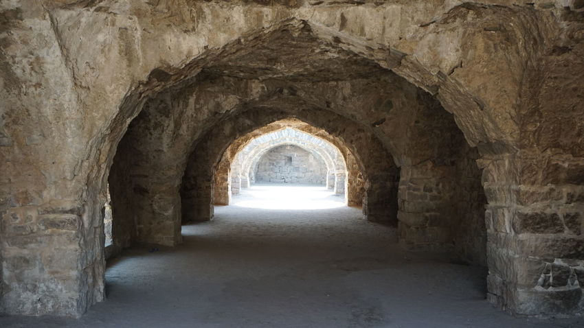 A cave like man made ancient monument at Golkonda Fort Arch Indoors  Corridor Architecture No People Day Stone Wall Stone Hyderabad Monuments Hyderabad Heritage Hyderabaddiaries Golkonda Fort, Hyderabad Nwin Photography Sonyalpha Sony A6000 Built Structure Architecture Cavelike