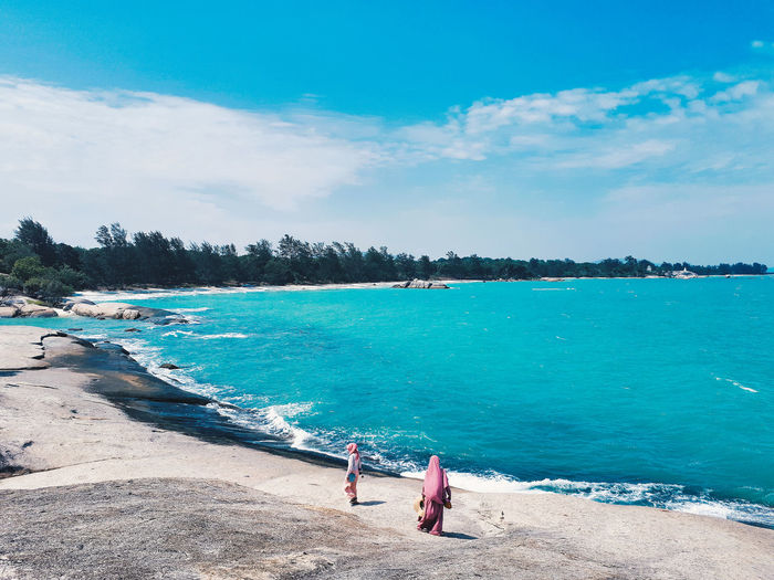 Hidden Paradise in Bangka . Bangka, Indonesia. Water Sky Sea Real People Beauty In Nature Nature Day Women Lifestyles Two People Cloud - Sky Scenics - Nature People Land Blue Beach Adult Rear View Men Outdoors Turquoise Colored EyeEm Best Shots EyeEm Nature Lover Nature Beauty In Nature