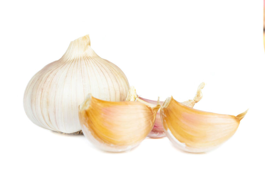 Garlic isolated on white background Eating Garlic Isolated Raw Aromatic Background Bulb Closeup Clove; Condiment; Flavor Food Fresh Gourmet Healthy; Ingredient Meal; Object Organic Ripe; Red; Grape; Crop; Vineyard; Fruit; Agriculture; Vine; Cabernet; Leaf; Plant; Green; Purple; Bunch; Blue; Cultivated; Nature; Autumn; Food; Wine Seasoning; Spice Vegetable; White; Whole;