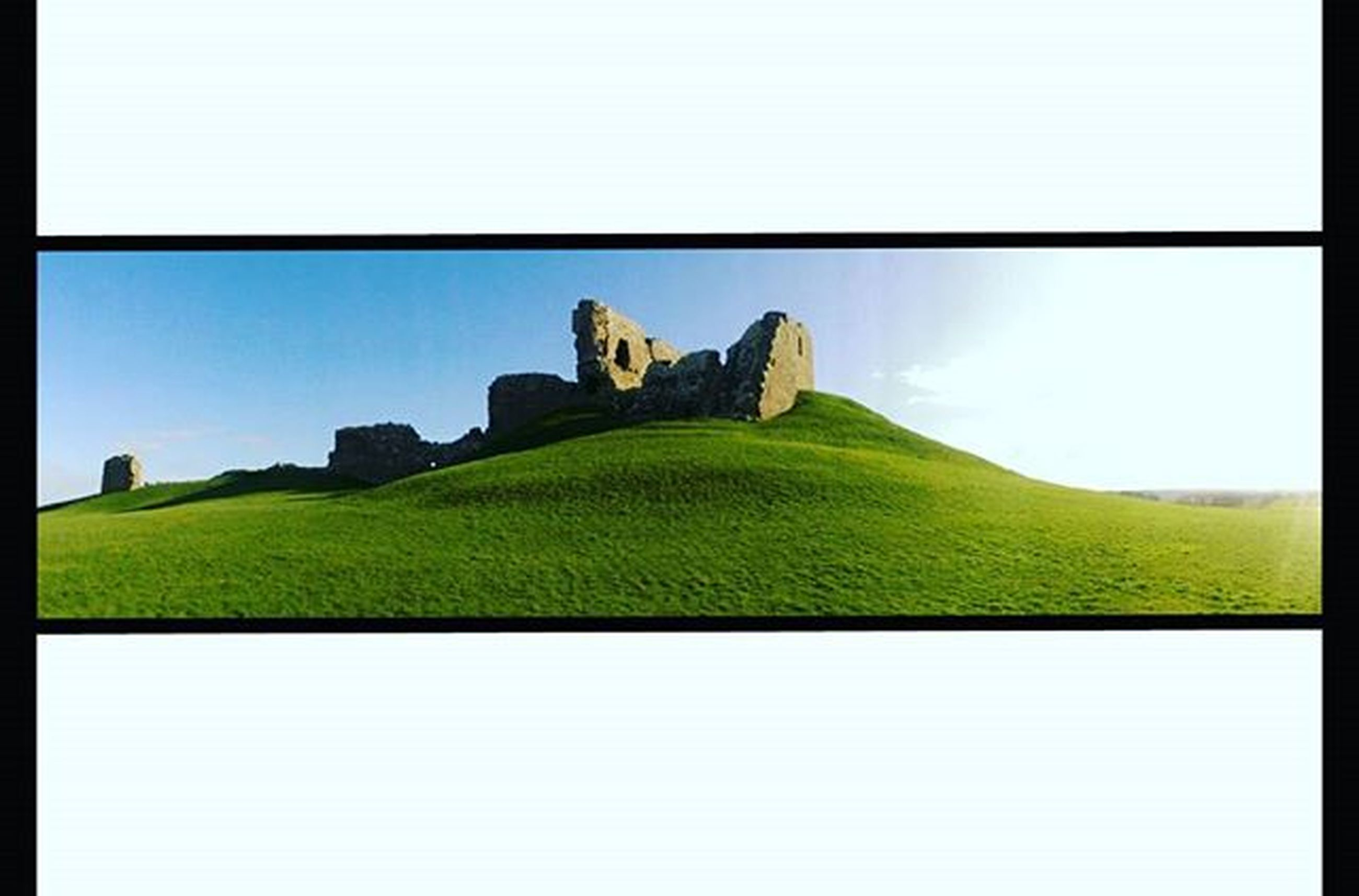 grass, landscape, green color, clear sky, sky, tranquility, tranquil scene, field, copy space, history, built structure, nature, scenics, transfer print, hill, architecture, old ruin, beauty in nature, ancient, grassy