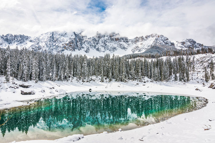 Winter Cold Temperature Beauty In Nature Snow Scenics - Nature Tranquil Scene Mountain Tranquility Water Cloud - Sky Sky Nature Plant Tree Day Non-urban Scene No People Idyllic Snowcapped Mountain Turquoise Colored