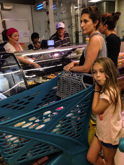 at the Kosher counter, before holiday Candid Candid Photography Child Childhood Daughter Expression Family Food Shopping Market Mom Retail  Streetphotography