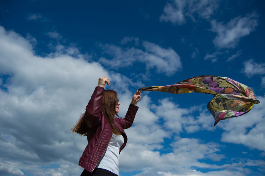 Great Outdoors Nature Blue Cloud - Sky Day Emotion Females Flying Girl Portrait Girls Hairstyle Human Arm Leisure Activity Lifestyles Long Hair Low Angle View Nature Outdoors Positive Emotion Real People Scarf Sky Wind Wind Motion Women The Fashion Photographer - 2018 EyeEm Awards
