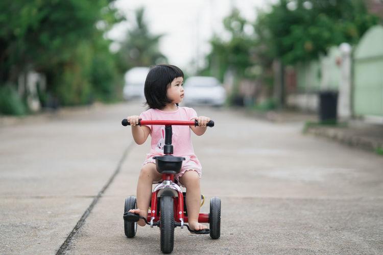 Cute girl riding cycle